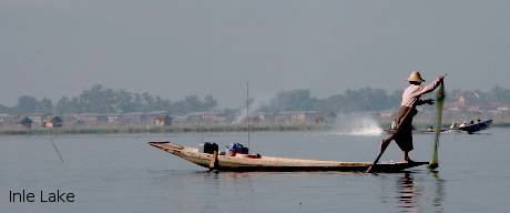 A fisherman rowing boat in Inle