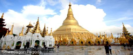 Shwedagon pagoda with white clouds background